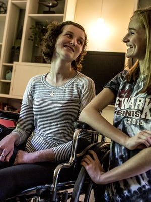 After suffering from a series of strokes in December 2013, Newark senior Hannah King has made a significant recovery. Her youngest sister, Rebecca, sits with her in their living room laughing as they joke and tease each other.