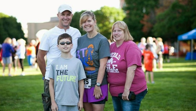 Pataskala resident Kimberly Kuhn, a brain tumor survivor, ran her first Breakthrough for Brain Tumors Run Walk in 2014. Here she is pictured with her husband Eric, son Nathaniel and mother Cora Rininger at that time.