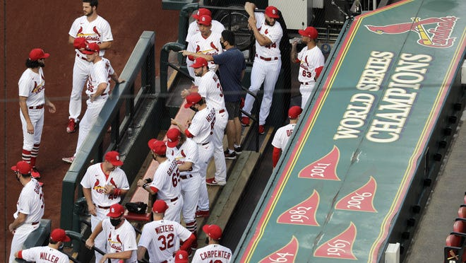 Members of the St. Louis Cardinals wait to be introduced before the start of a game against the Pittsburgh Pirates on Friday, July 24, in St. Louis.