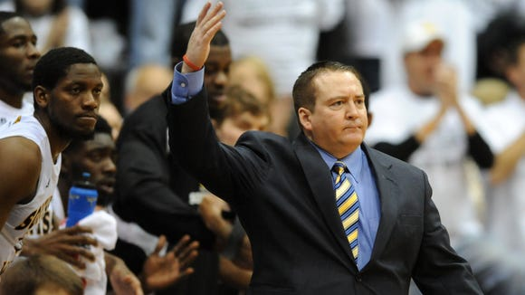 Southern Miss head coach Donnie Tyndall pumps up the crowd as they take on Louisiana Tech.