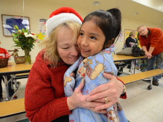 """Howe Elementary School kindergarteners got a gift of warmth and affection from """"Grandma"""" Grace Treml on Friday. Treml made 112 blankets for the students."""
