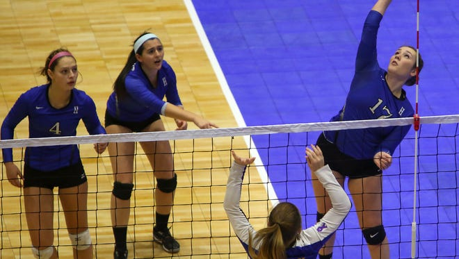 Haldane's Nicole Etta spikes the ball during the Blue Devils' 25-15 and 25-16 victories over Mayfield at the NYS Girls Volleyball Championships at the Glens Falls Civic Center on Saturday, Nov. 21, 2015.