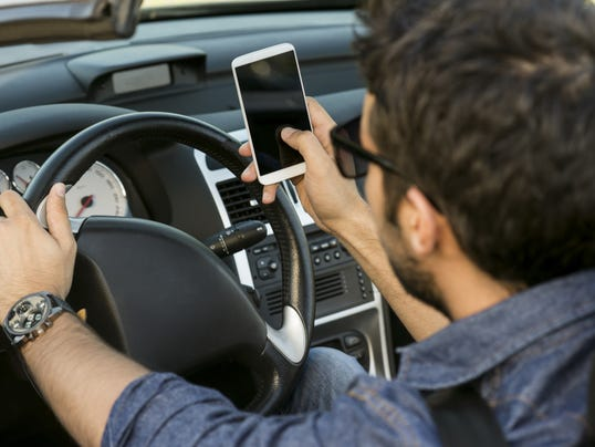 Man texting while driving.