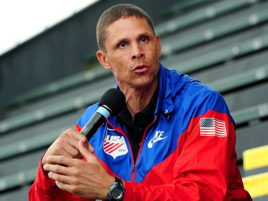 Dan O'Brien, 1996 Olympic decathlon gold medalist, gives advice to the athletes after the first day of the OSAA Track & Field Championships inside Hayward Field at the University of Oregon, on Thursday, May 21, 2015, in Eugene. O'Brien will be at the championships all weekend.