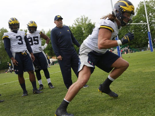 Michigan defensive coordinator Don Brown leads player