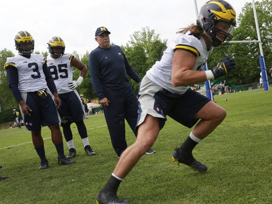 Michigan defensive coordinator Don Brown leads player into drills during their first practice in Rome at Giulio Onesti Training Center on Thursday, April 27, 2017.