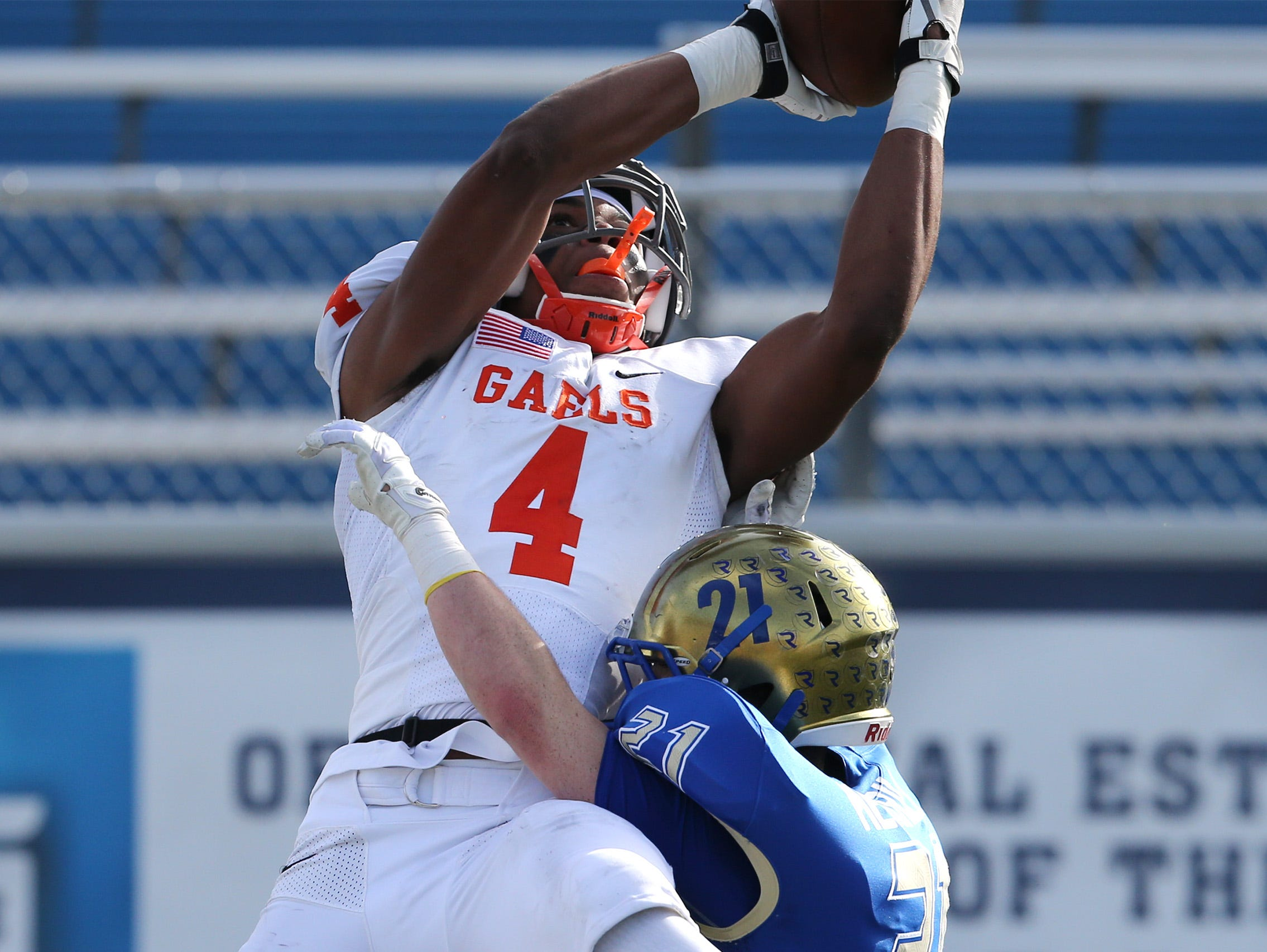 Bishop Gorman's Cedric Tillman goes up for a reception against Reed's Chase Merrill during the first half of the NIAA 4A state championship football game in Reno, Nev., on Saturday, Dec. 2, 2017.