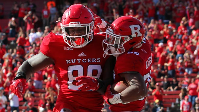 Raheem Blackshear (25) of the Rutgers Scarlet Knights celebrates his 35 yard touchdown catch with Nixon Provillon (80) against the Purdue Boilermakers during the third quarter of a game at Rutgers on October 21, 2017 in Piscataway.