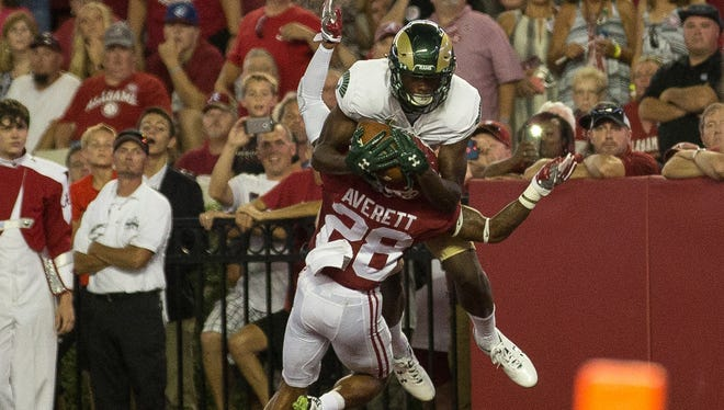CSU receiver Warren Jackson, a true freshman, makes a touchdown catch while being covered by Alabama cornerback Anthony Averett during Saturday night's game in Tuscaloosa, Ala. Jackson is one of a handful of young stars CSU coach Mike Bobo and his staff are developing into play-makers early this season.