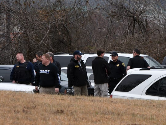FBI agents stand outside the Knoxville Pain Care clinic Tuesday, March 10, 2015.