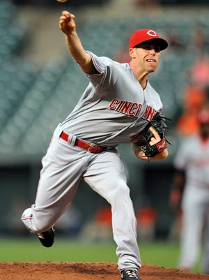 Sep 3, 2014; Baltimore, MD, USA; Cincinnati Reds starting pitcher Dylan Axelrod (40) pitches in the first inning against the Baltimore Orioles at Oriole Park at Camden Yards. Mandatory Credit: Joy R. Absalon-USA TODAY Sports