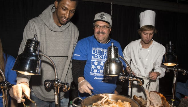 Stan Van Gundy and Kentavious Caldwell-Pope at the Pistons' annual Thanksgiving dinner Nov. 18, 2015.
