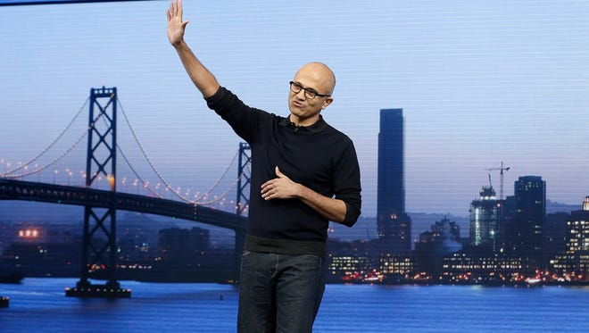 Microsoft CEO Satya Nadella waves after speaking at the Microsoft Build conference in San Francisco, Wednesday, April 29, 2015. While Microsoft has already previewed some aspects of the new Windows 10, a parade of top executives will use the conference to demonstrate more software features and app-building tools, with an emphasis on mobile devices as well as PCs.