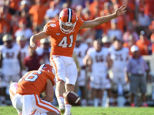 Clemson place kicker Alex Spence (41) kicks an extra
