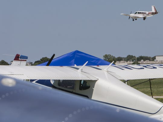 Thousands of airplanes arrive to the EAA grounds to