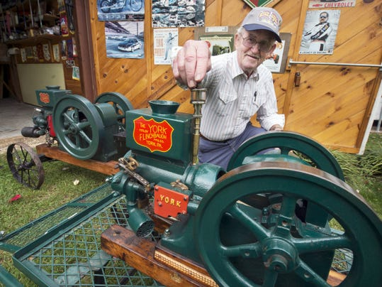 Harry Wildasin Jr. shows his Flinchbaugh Manufacturing hit and miss engines at his home in North Codorus Township. He plans to sell a rare one-half horsepower hit and miss engine at an upcoming auction next month.