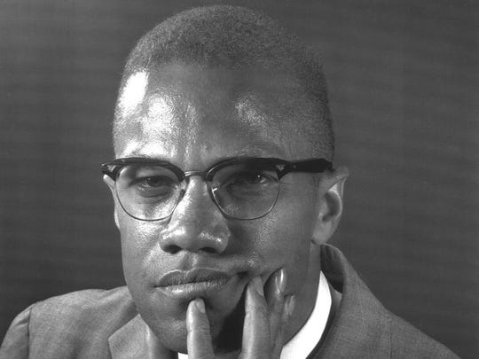 Muslim leader Malcolm X poses in this 1964 portrait.