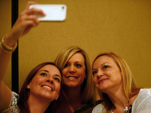 Jenci Spradlin, Beth Parnell and Sheila MacDiarmid (left to right) take a selfie at the Jackson Young Professionals local government session Wednesday at Union University's Carl Grant Events Center.