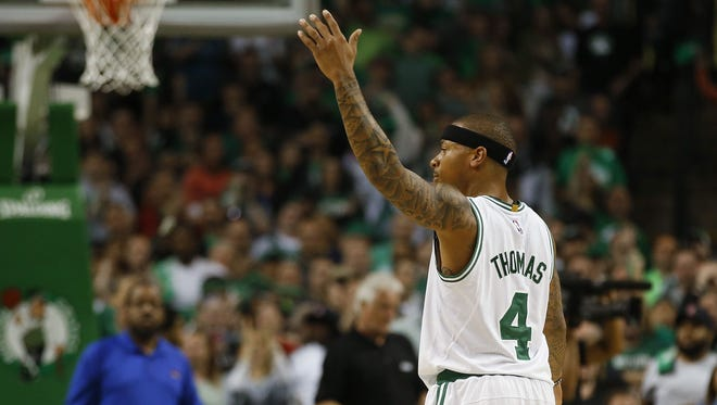 Boston Celtics guard Isaiah Thomas reacts during the second half of the Boston Celtics 123-111 win over the Washington Wizards.