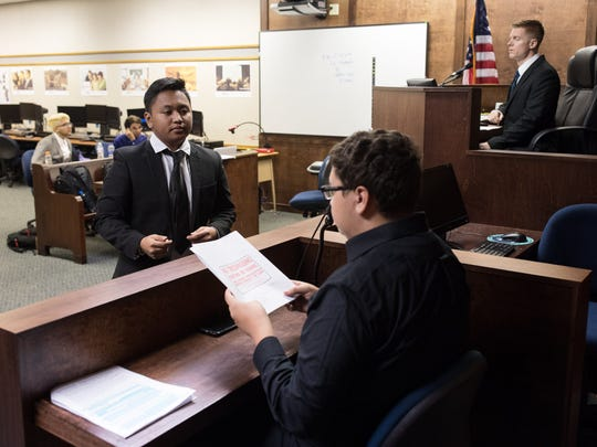 Collegiate high school student Rodger Marin, acting as a lawyer, questions a witness as Collegiate High School's mock trial team practices for an upcoming competition.