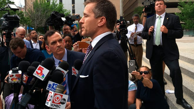Missouri Gov. Eric Greitens speaks at a news conference outside court on Monday, May, 14 2018, in St. Louis. Prosecutors on Monday abruptly dropped an invasion-of-privacy charge against Greitens but say they hope to refile the case. The surprise move came at the end of a third day of jury selection for the Republican governor's trial. (AP Photo by Jim Salter)