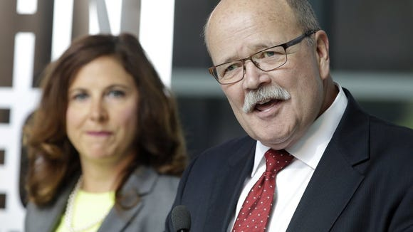 AP file photo by Darron Cummings Democratic Indiana gubernatorial candidate John Gregg, right, speaks during a news conference in Indianapolis.