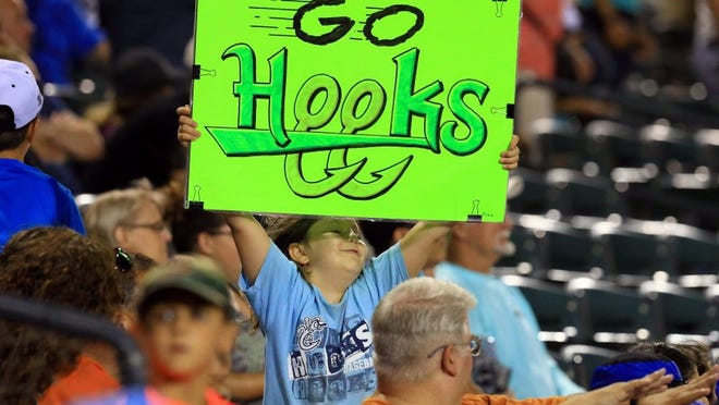 GABE HERNANDEZ/CALLER-TIMES A Hooks fan holds a sign at Whataburger Field on Saturday as the team took on Frisco.
