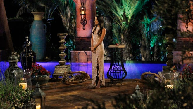 """Kaitlyn stands with the last rose before making her choice on the season finale of """"The Bachlorette."""""""