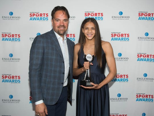 Mike Piazza (Hall of Fame Baseball Player) and Elle Morse of Leonia/Palisades Park (Girls Swimmer of the Year Award). NorthJersey.com and the USA Today Network hosted its second annual Sports Awards at bergenPAC in Englewood. The evening honored high school athletes across north jersey and featured Hall of Fame baseball player Mike Piazza as the guest speaker. 06/14/2018