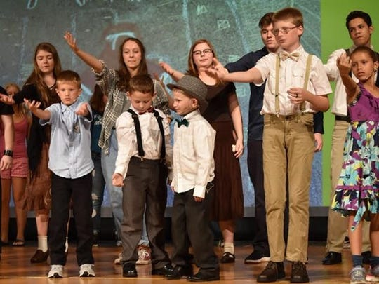 """L-R: Alex Dunlap, Nash Scott, Remy Newton, Austin Hewkin and Amaya Rogers perform during dress rehearsals for the Penguin Project production of """"Annie Jr."""""""