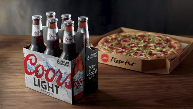 Pizza Hut launches beer delivery to nearly 100 stores in Arizona and California.