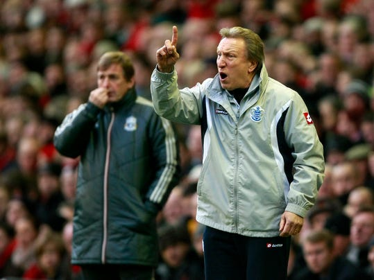 FILE - In this file photo dated Saturday Dec. 10, 2011 Queens Park Rangers manager Neil Warnock, foreground, and Liverpool manager Kenny Dalglish react during their English Premier League soccer match at Anfield, Liverpool, England. Neil Warnock has been hired by Crystal Palace for his second spell as the manager of the Premier League club, it was announced on Wednesday, Aug. 27, 2014.  (AP Photo/Tim Hales, File)