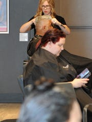 Hairstylist Margaret Smith trims one her customer's hair on May 11 in the newly opened Fantastic Sams Cut and Color Hair Salon, 3801 Call Field Road near Jersey Mikes Subs. Store owner Shane Ballard said the salon will offer a full menu of services such as haircuts, color, styling and facial waxing.