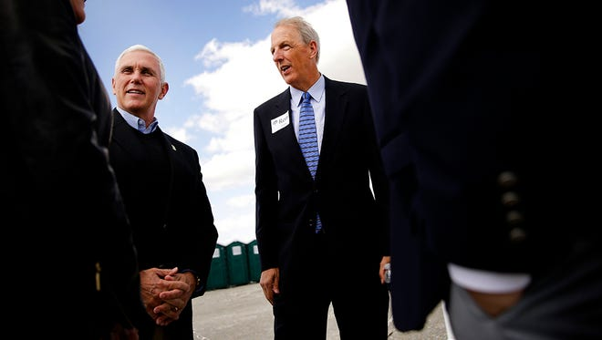 Indiana Governor Mike Pence, middle left, is greeted by Traders Point Christian Academy's Head of School Ron Evans, middle right, before a groundbreaking ceremony for the new Traders Point Christian High School's phase one, which includes a new 21st century academic facility and turf athletic field on May 15, 2016.