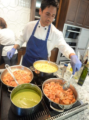 Chef Gabriel Balderas of El Cabo Verde prepares a Shrimp Corn Esquites for the attendees of the Society of the Golden Fork.