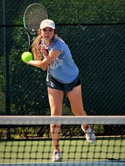 Clyde's Elizabeth Dugan fires a serve during the Region