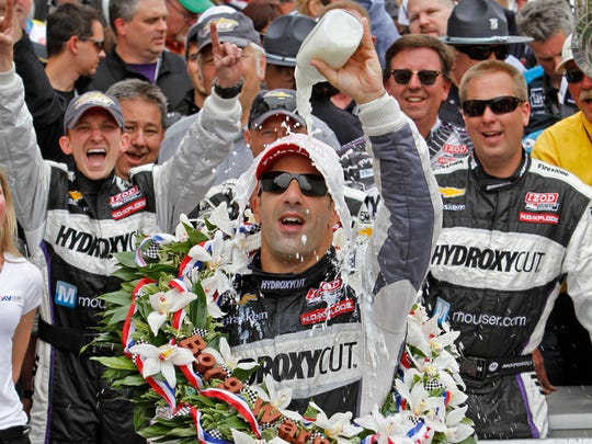 Indy 500 winner Tony Kanaan pours milk over his head in victory circle after winning the 97th running of the Indianapolis 500, at the Indianapolis Motor Speedway, Sunday, May 26, 2013.  Kelly Wilkinson / The Star