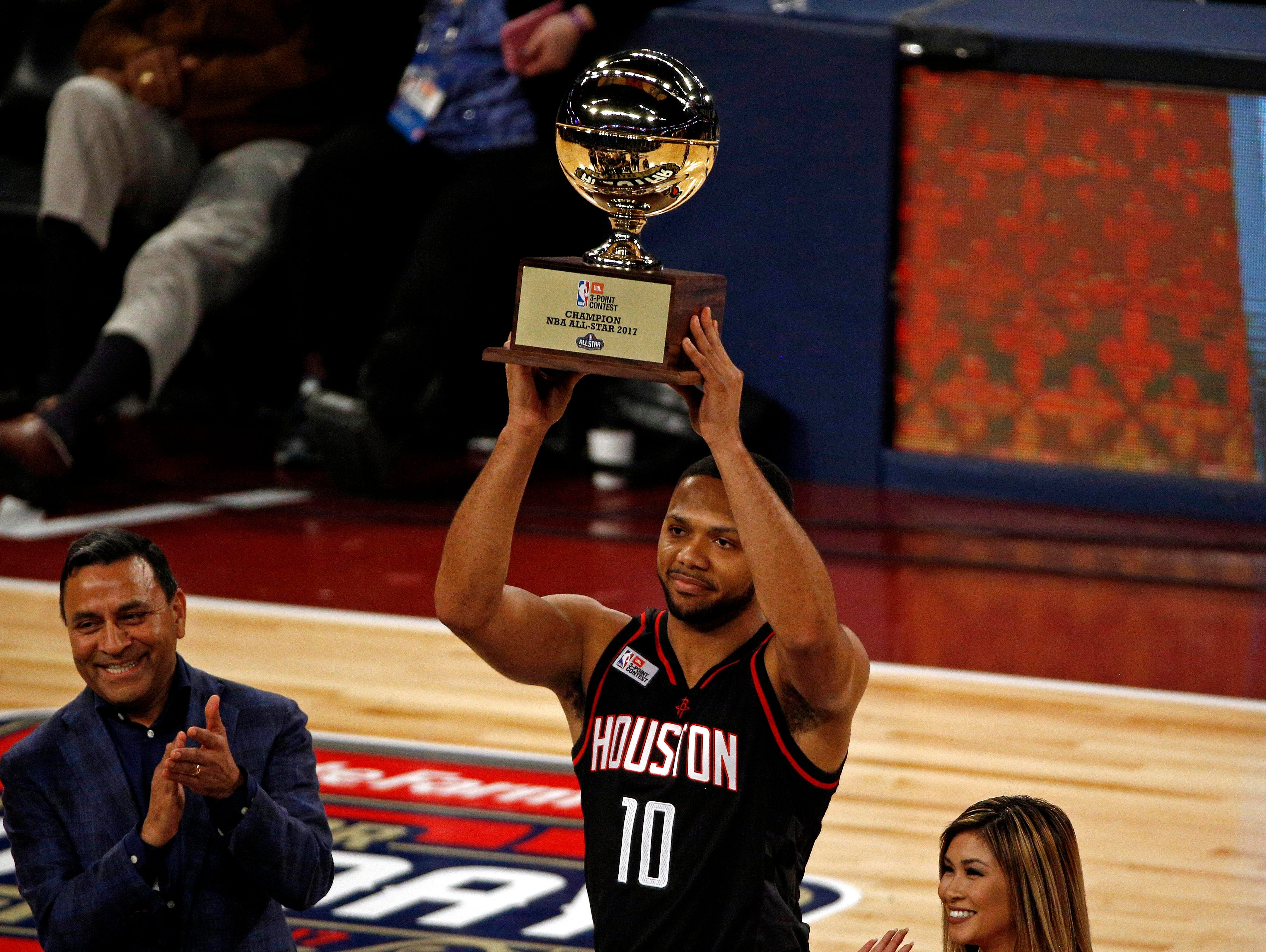 Feb 18, 2017; New Orleans, LA, USA; Houston Rockets guard Eric Gordon (10) celebrates winning the three-point contest during NBA All-Star Saturday Night at Smoothie King Center.
