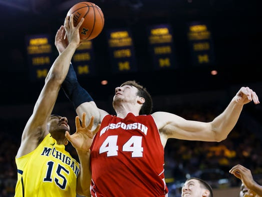 Michigan Wolverines forward Jon Horford (15) and Wisconsin Badgers forward Frank Kaminsky (44) goes for the rebound in the second half at Crisler Arena.