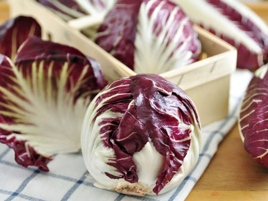 Radicchio comes in small, round, cabbage-like heads.