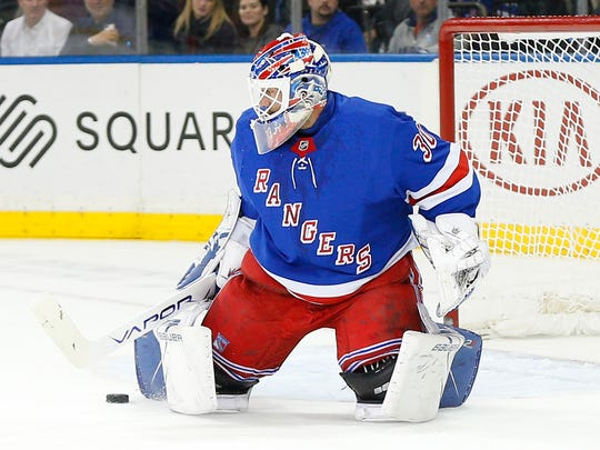 Feb 3, 2020; New York, New York, USA; New York Rangers goaltender Henrik Lundqvist (30) makes a save against the Dallas Stars during the first period at Madison Square Garden. Photo Credit: Andy Marlin - USA TODAY Sports
