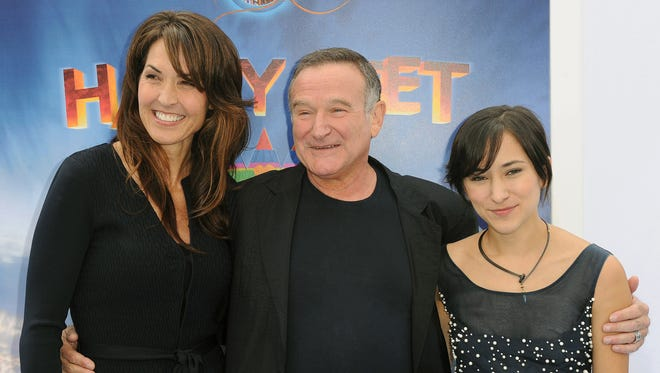 A 2011 photo shows Susan Williams  (then Schneider) with Robin and Zelda Williams at the premiere of  'Happy Feet Two.'