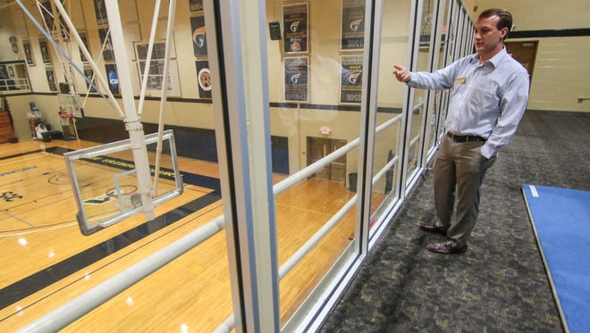 Matthew Finley, Senior Associate Athletic Director at Anderson University, looks at Annie Tribble Court in the Abney Athletic Center where seats will be added and the glass wall taken down.