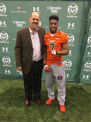 CSU coach Mike Bobo poses for a photo with cornerback Dominique Williams during his official recruiting visit over the weekend. Williams said Monday he plans to sign with the Rams this week.
