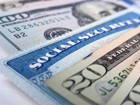 Social security card and American money dollar bills