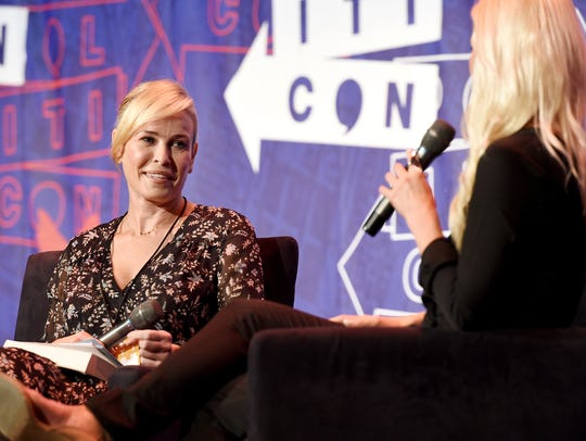 Comedian Chelsea Handler, left, talks with conservative