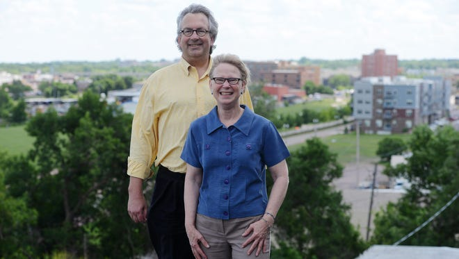 Jeff and Sheila Hazard on the roof of one of their buildings, The Bakery on North Main Avenue.