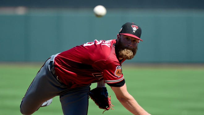 Mar 12, 2017: Arizona Diamondbacks starting pitcher Archie Bradley (25) throws during the first inning against the San Francisco Giants during a spring training game at Scottsdale Stadium.