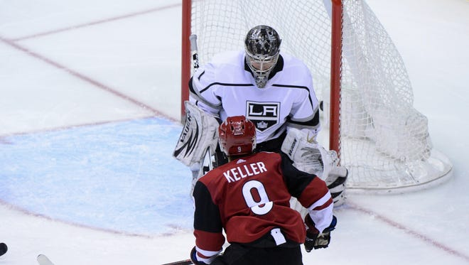 Mar 13, 2018: Arizona Coyotes center Clayton Keller (9) scores on Los Angeles Kings goalie Jack Campbell (1) during the first period at Gila River Arena.