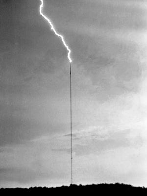 A jagged bolt of lightning streaks downward from the storm clouds to strike the WSM-TVÕs tower on Knob Road during one of the worst thunderstorm in recent years roared through July 7, 1966.